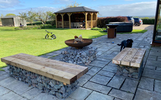 Chris' gabion Seating and Firepit, using sleepers for tops.